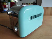 Pop-up electric toaster. Hardly used. 3 settings. Turquoise and chrome.