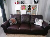 Three seater dark brown leather sofa
