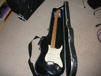 USA Fender Stratocaster 2002 Black with white scatch plate