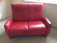 Red leather two and three seater sofa