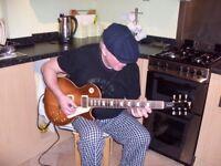 Mature guitar player