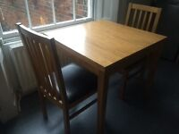 Small extending solid oak dining table & 2 chairs