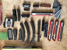 Hornby inc 3 x DCC trains, controller, multiple carriages, lots and lots of 00 track and accessories