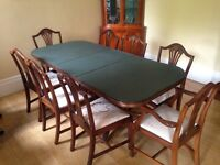Quality mahogany dining table and eight chairs