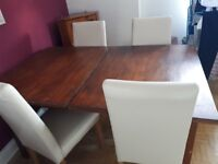 Large extendable wooden dining table and chairs