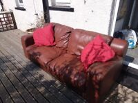 Brown leather 3+2 seater sofas.