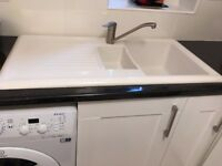 Reginox 1.5 bowl ceramic sink with basket strainer and plumbing fittings brand new.