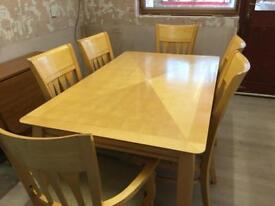 Dinning table and six chairs...reduced open to sensible offers!