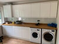 Various utility room units and worktop and splashback