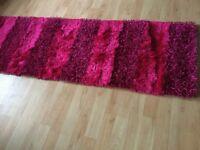 Hall way pink rug