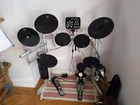 Electric drum kit plus amp, kong HxM kit with a Behringer ultracoustic AT108 amp.