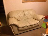 Cream two seater leather sofa - smoke and pet free home - £35 ono