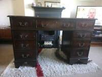 Dark wood twin pedestal writing desk