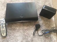 Sky + HD box, router and remote