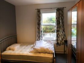 Double room with working people in LU2