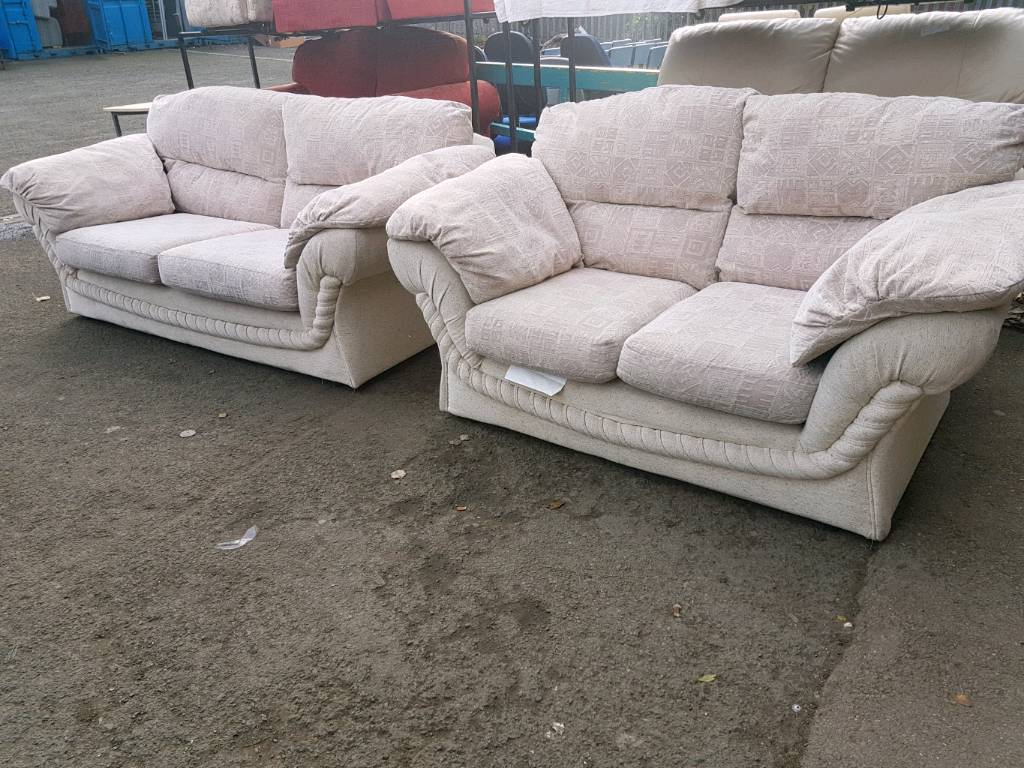 Grey patterned fabric twin two seater sofas