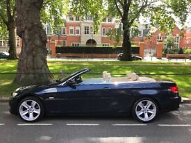 Navy blue convertible BMW 3.0 325iSE