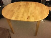 Solid wood extending dining table (4 to 6 seats) for £110