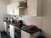 White gloss kitchen with black laminate worktop