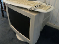 Older type computer monitor and keyboard.