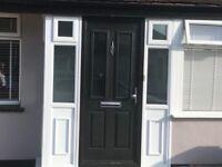 Composite front door including side panels