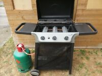 a very new barbecue by gas