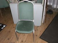 23 green banqueting chairs and 10 brown stacking chairs