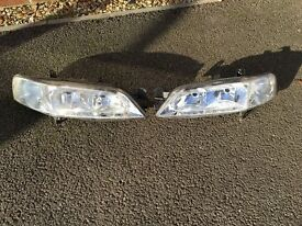 Pair of Genuine Vauxhall Vectra headlights for a 1999 year model in perfect order