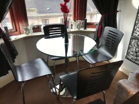 For sale table and 4 black chairs