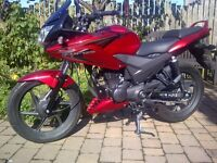 Honda CBF 125cc, only 273 miles - good as new. Ideal first bike. Red and beautiful.