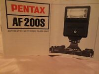 Pentax AF200S SLR flash gun in original Pentax box, pouch and packing.