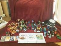 All of my Skylander figures, games, cards, traps and portals.