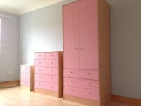 Childrens pink wardrobe, chest of drawers & bedside cabinet.