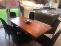 Dinning Room Table and six black velvet chairs & sideboard