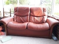 Brown Stressless two-seater reclining sofa, chair and foot stool. Great condition & so comfortable!