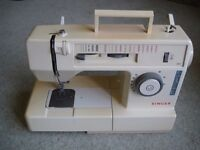 Singer 2112 sewing machine with manual, accessories, foot pedal, power cord, cover and sewing box