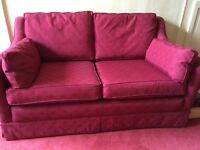 Dark red two seater sofa, neat, clean and comfortable