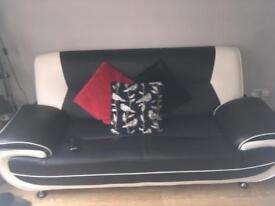 black and white 2+3 seater couch
