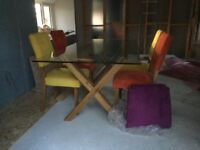 Glass topped oak dining table and 6 chairs for sale. Table 180cm x 90cm.