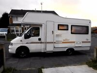 THIS MOTORHOME IS FULLY LOADED AND IN GREAT CONDITION AND VERY LOW MILAGE