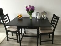 IKEA Dining table & 4 chairs (including 2 cushion covers)