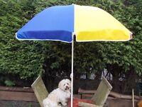 Large multi coloured beach parasol with tilt action