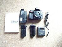 Nikon D600 DSLR body + battery grip, batteries.