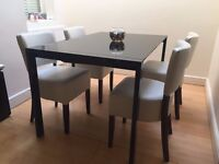 Black glossy dining table (extendable) and 5 cream chairs (also sold separately)- perfect condition