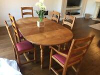 Solid French Oak extendable dining table and six chairs