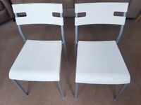 2 IKEA white chairs