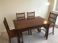 Solid mahogany dining table and six chairs