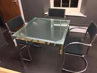 Glass table with 3 chairs