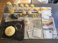 Medela swing pump with calma with extra bottles - hardly used