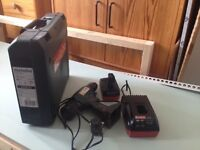 Metabo cordless drill, battery and charger.